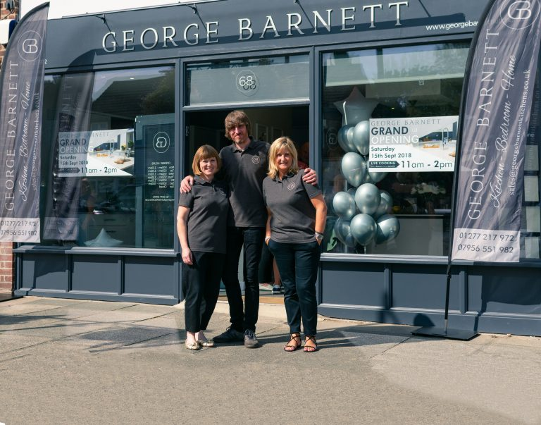 Staff outside George Barnett showroom