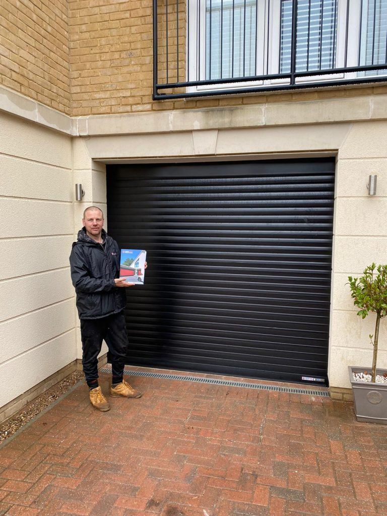 Spitfire Garage Doors with Richard holding brochure